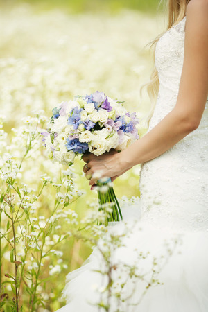 sanctification: The bride and the bridal bouquet Stock Photo