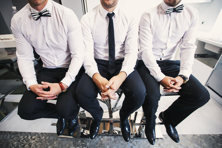barstools: Three men in white shirts and butterfly tie