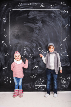 Thoughts of children against the black chalkboards photo