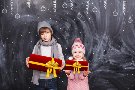 Boy and girl with Christmas gifts photo