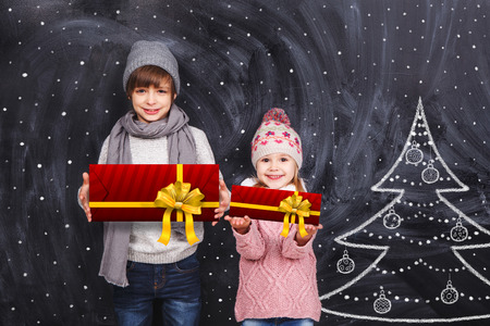 Children with Christmas gifts photo