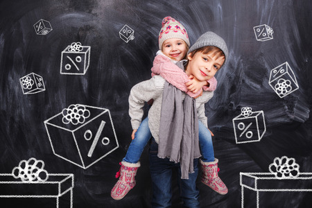 Boy and girl with a coupon boxes photo