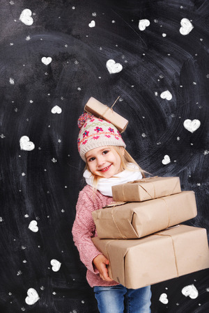 Girl with gifts on a background of hearts photo