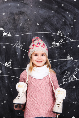 Little girl with skates on her neck photo