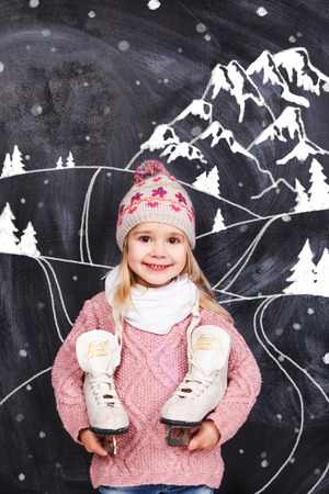 Little girl with skates photo