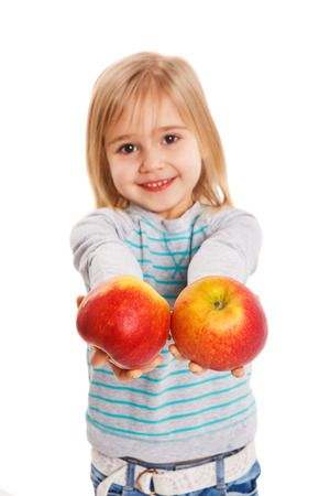 a little dinner: The little girl holds in hand ripe apples on a white background Stock Photo