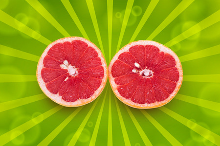 two and a half: Two half of  ripe grapefruit on a white background Stock Photo