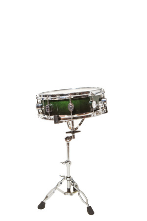 snare drum: Snare drum at the front on a white background with drumsticks on it