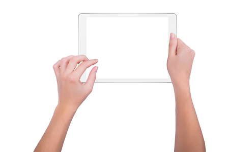 tablet devices: Woman working on white tablet Stock Photo