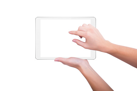 Girl increases the picture on the screen of the tablet 版權商用圖片
