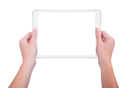 tablet devices: In the hands of girl white tablet