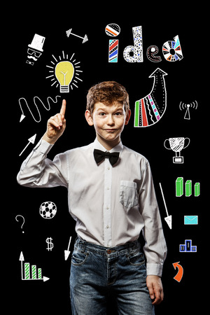 laughable: The red-haired boy on a black background with a white shirt holding thumbs up