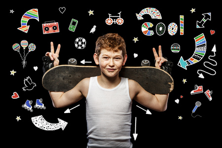 strong boy: Boy with red hair with skateboard and helmet on a black background Stock Photo