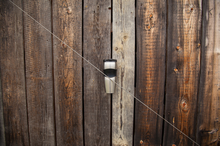 thermo: Thermo cup on a wooden fence