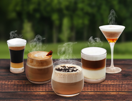 Variety of coffee on wooden table around tree 版權商用圖片