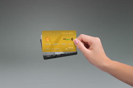 net income: Isolated gold two more cards in woman hand
