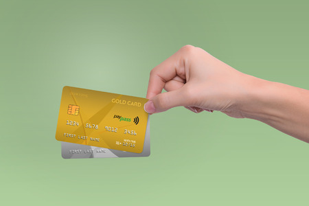 Isolated gold and gray credit cards in woman hand