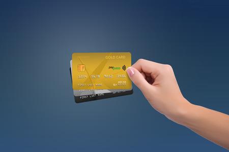 격리 된 금 및 여자 손에 두 개의 더 많은 카드 스톡 콘텐츠
