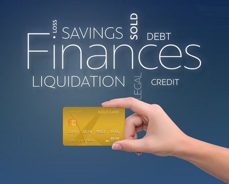 dividend: Business text on blue background with gold credit card Stock Photo
