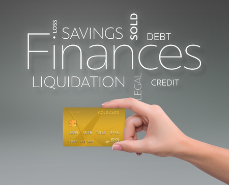 Business text on blue background with gold credit card 版權商用圖片