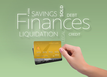 Business text on green background with three credit card