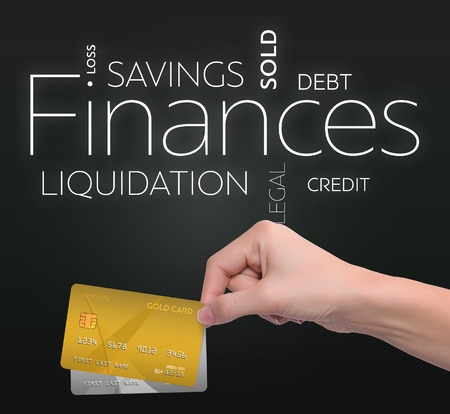 Business text on black background with two credit card
