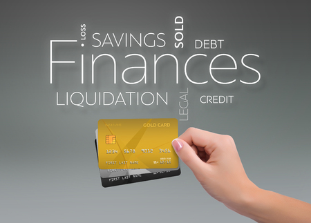 Business text on gray background with three credit card