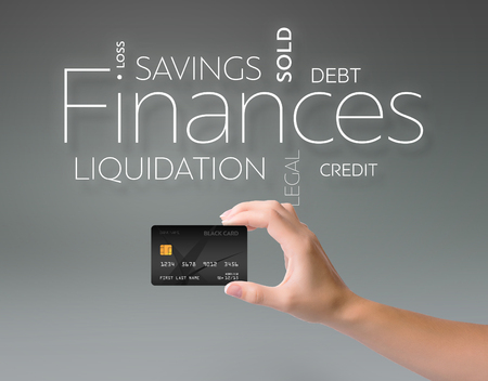 Business text on gray background with black credit card