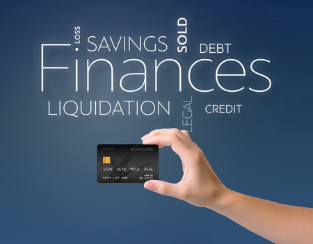 dividend: Business text on blue background with black credit card Stock Photo