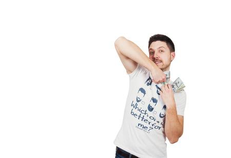 Man in white T-shirt tears money 版權商用圖片
