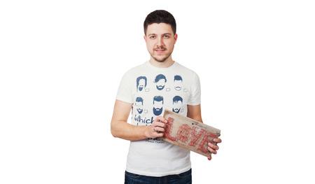 Man holds board with Love written on it 版權商用圖片