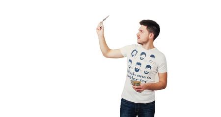 fake money: Man in T-shirt checks money Stock Photo
