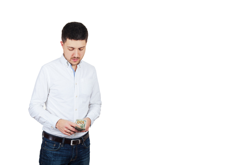 Man in white shirt counts money