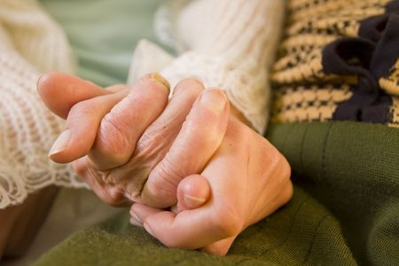 A young woman holding a senior woman's hand. Stock Photo - 6761653