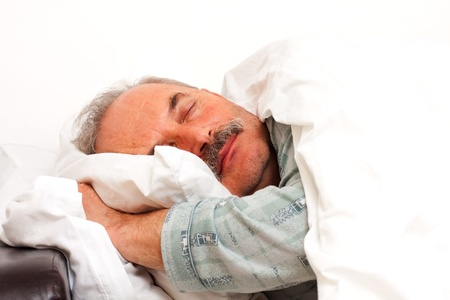 sleeping rooms: A senior man sleeping in bad.