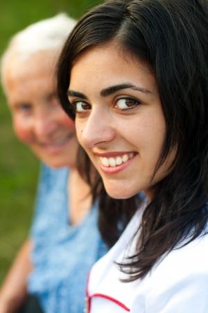 incapacity: Doctor  Nurse sitting next to an elderly woman Stock Photo
