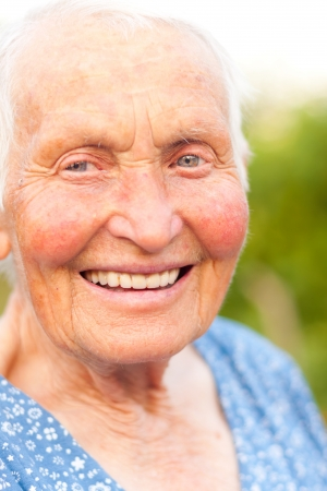hoar: Elderly woman with blue eyes having toothy smile.