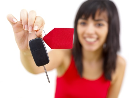 lable: Happy young woman holding new car keys with lable.