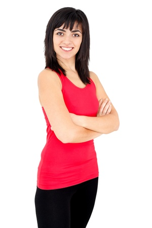kindly: Happy confident young woman standing and smiling kindly isolated on white.