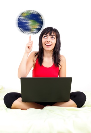 Young woman with laptop spinning the earth while spending time on the Internet  Stock Photo - 20772345