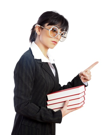 forbidding: Young teacher with big funny glasses looking severely threatening with her finger - part of a series. Stock Photo