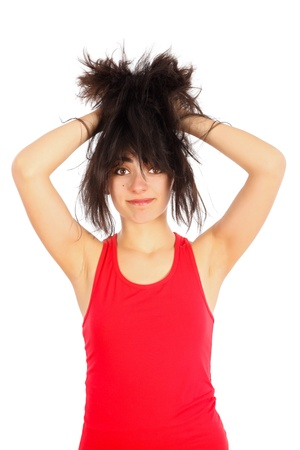 pull out: Beautiful woman in red tearing her hair because it is messy. Stock Photo