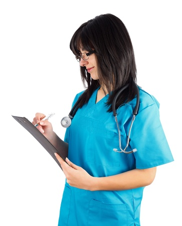 phisician: Kind brunette doctornurse in blue coat writing on her clipboard. Stock Photo