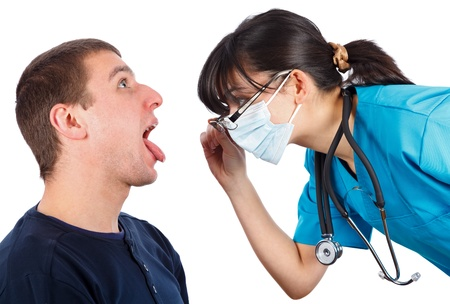 phisician: Woman doctor checking a male patients throat. Stock Photo