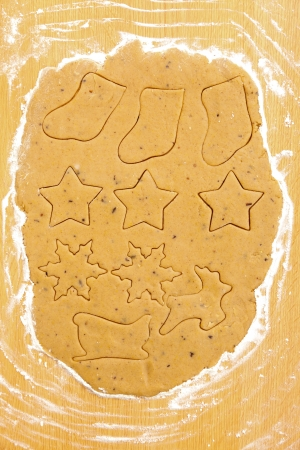 Different Christmas symbols in dough on the table. photo