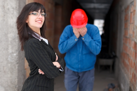 cynical: Arrogant employer being happy for winning a fight with the employee. Stock Photo