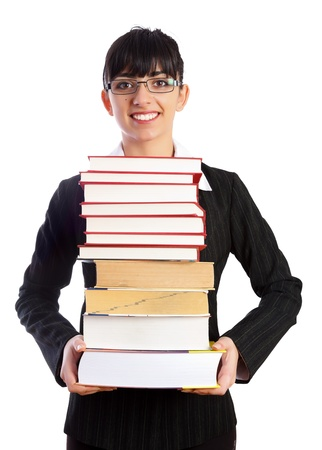 kindly: A kindly looking teacher smiling with book tower in her hands isolated on white - part of a series.