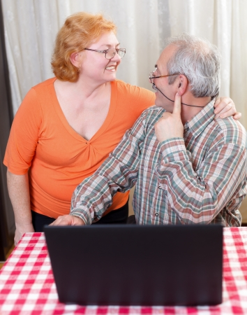 Elderly couple hugging each other at home. Stock Photo - 20794265