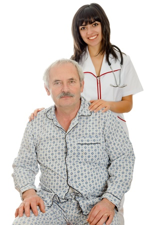 kindly: Young doctornurse smiling kindly standing behind a senior patient.