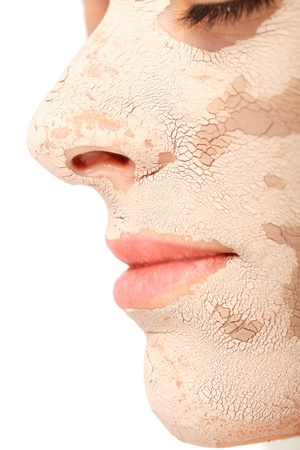 Close-up view of a beautiful woman with dry clay mask on. Stock Photo - 20794614